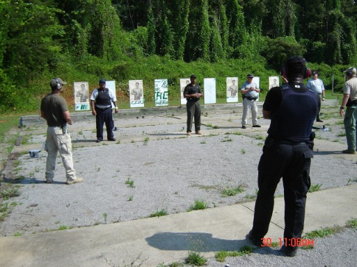 Instructor Leon S. Adams talking to Security Professionals on the firing line during Handgun Street Ready Skills