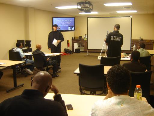 Instructor Joseph Hibner going over Handgun Safety during Introduction to Handguns  for SelfDefense