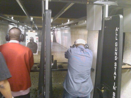 Shooters on the firing line during Handgun Skills for Personal Defense