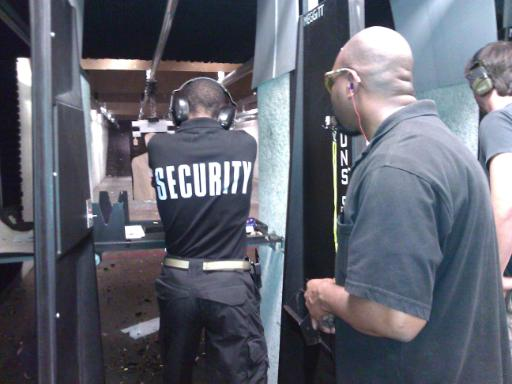 Instructor Leon S. Adams monitors a security officer during the live fire portion of Handgun Skills for Personal Defense