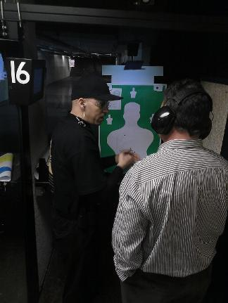 Instructor Hibner on the firing line coaching a student during Handgun Skills and FUNdamentals class  in Atlanta
