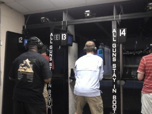 Instructor Leon S. Adams going over a course of fire on Handgun Safety during Handgun Skills for Personal Defense