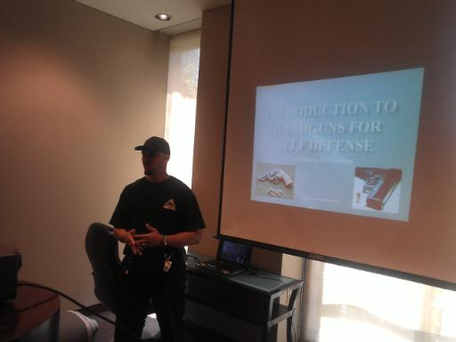 Instructor hibner teaches about the basics of Handgun Safety during Introduction to Handguns for Self Defense