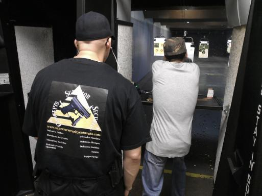 Instructor Joseph Hibner monitoring a student during the live fire portion of Introduction to Handguns for Self Defense